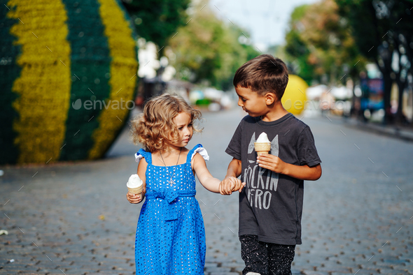 little boy and little girl with ice cream - Stock Photo - Images