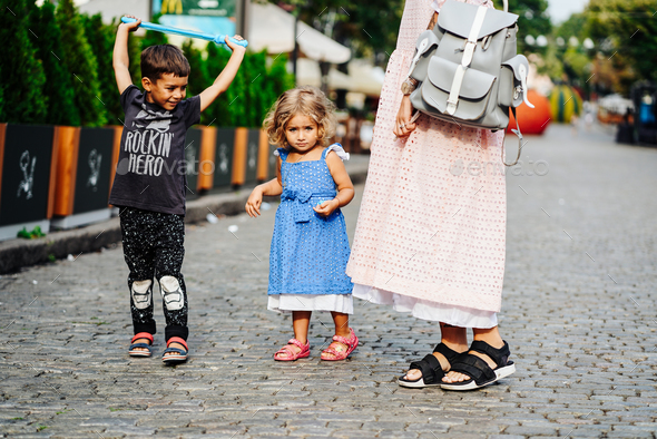 little boy and girl on the street - Stock Photo - Images