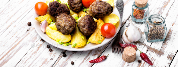 Meat balls with baked potatoes - Stock Photo - Images