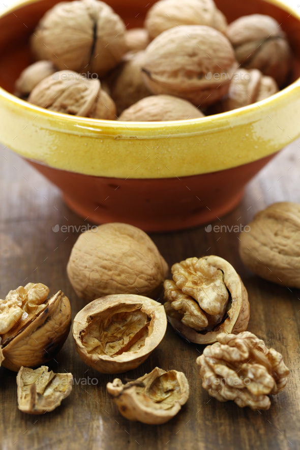 walnuts, kernel and shell on wooden background - Stock Photo - Images