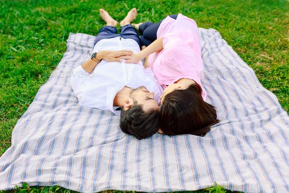 Young loving couple lying together enjoying closeness - Stock Photo - Images
