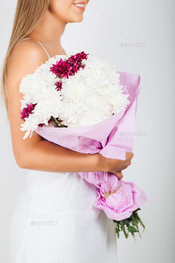 Close-up delicate woman hands holding bunch of flowers - Stock Photo - Images
