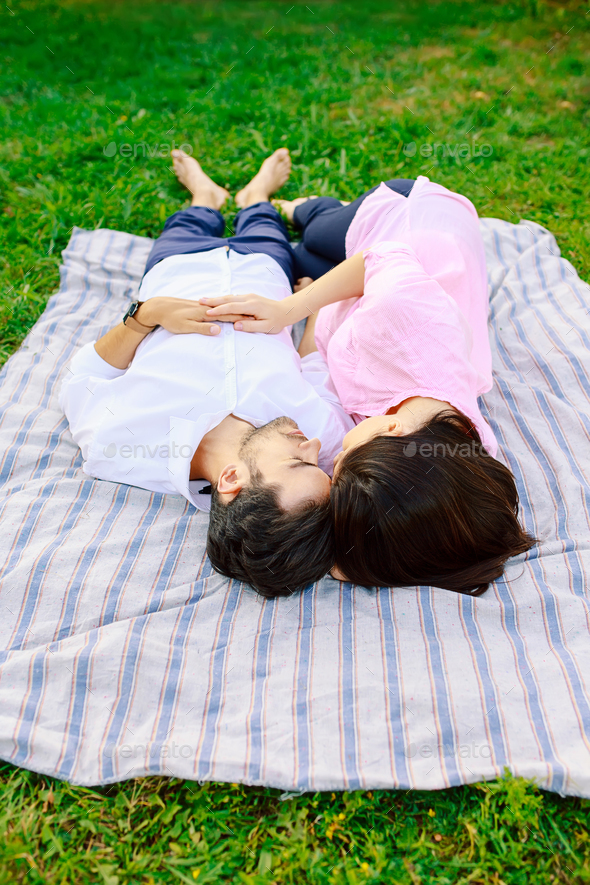 Young loving couple lying together enjoying closeness - Stock Photo - Images