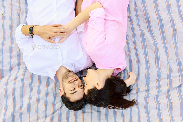 Happy young man and woman looking in love to each other - Stock Photo - Images