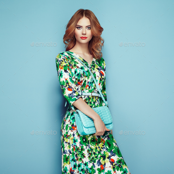 Blonde young woman in floral spring summer dress - Stock Photo - Images