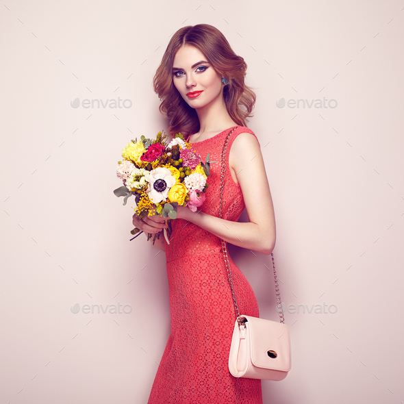 Blonde young woman in elegant red dress - Stock Photo - Images