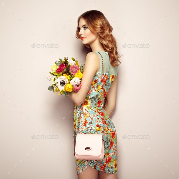 Blonde young woman in elegant floral dress - Stock Photo - Images