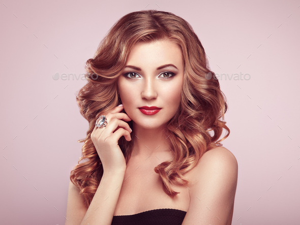 Blonde woman with long shiny wavy hair - Stock Photo - Images