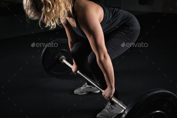 Sporty Female Lifting Weights - Stock Photo - Images