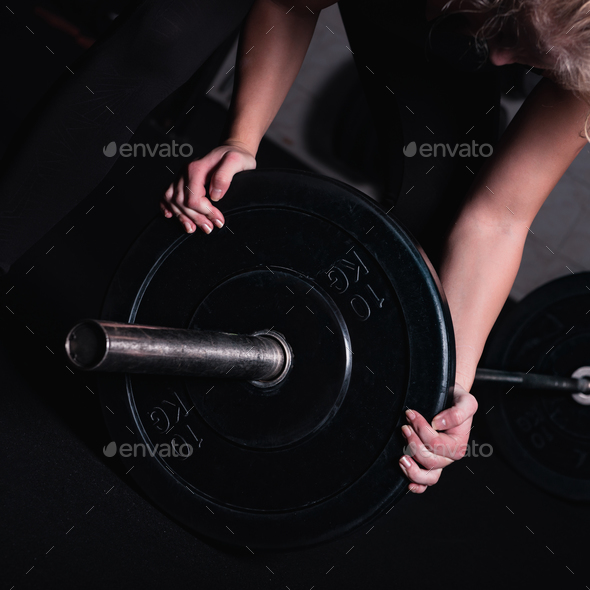 Sporty Woman With Barbell In A Gym - Stock Photo - Images