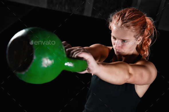 Young Women Doing Kettlebell Exercises - Stock Photo - Images