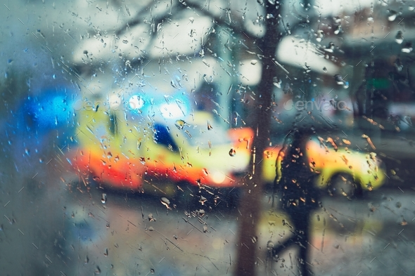 Emergency medical service in the rain - Stock Photo - Images
