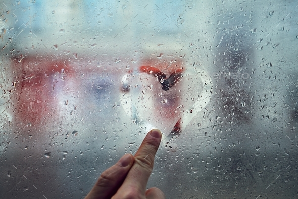 Heart shape on the window - Stock Photo - Images