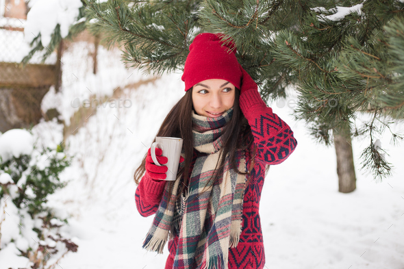 Beautiful happy smiling woman with a cup in the winter on the street - Stock Photo - Images