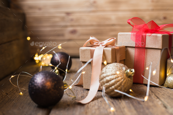 Christmas gift box with decoration on wooden background - Stock Photo - Images