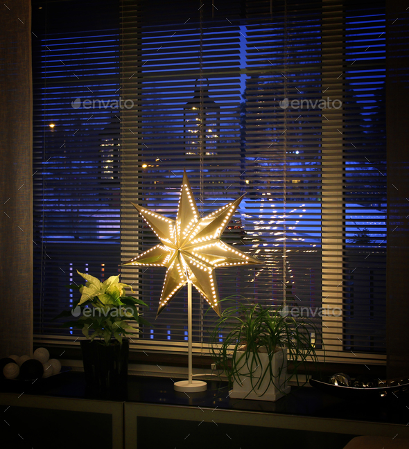 Christmas star decor by window - Stock Photo - Images