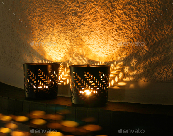 Small candle cups reflecting light - Stock Photo - Images