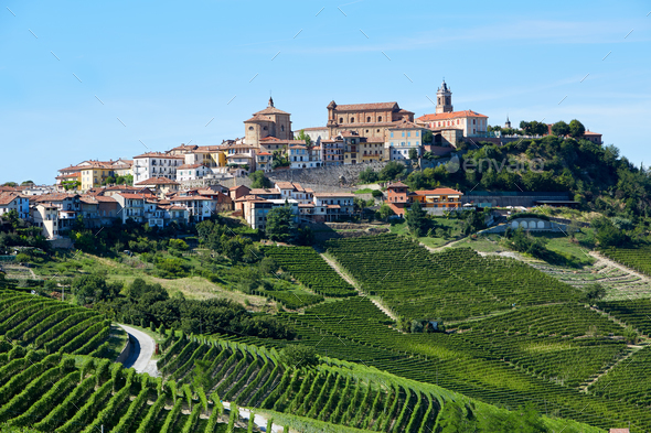 La Morra town in Piedmont, Langhe hills in Italy, blue sky - Stock Photo - Images