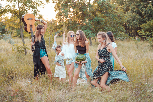 Six girls in nature have fun - Stock Photo - Images