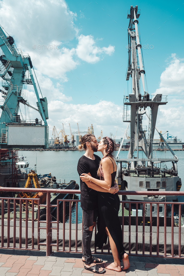 Guy and girl in the docks - Stock Photo - Images