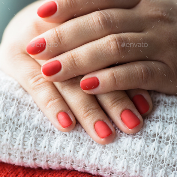 Closeup photo of a beautiful female hands with red nails - Stock Photo - Images
