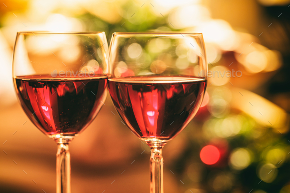 Two glasses of wine near a fireplace - Stock Photo - Images