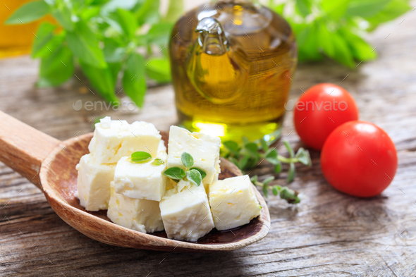 Feta cheece pieces on wooden background - Stock Photo - Images