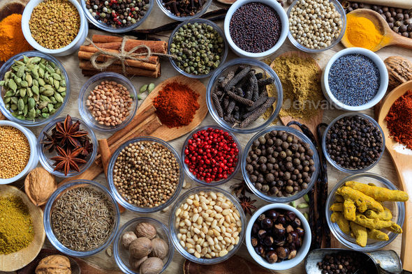 Composition of spices on a wooden surface - Stock Photo - Images