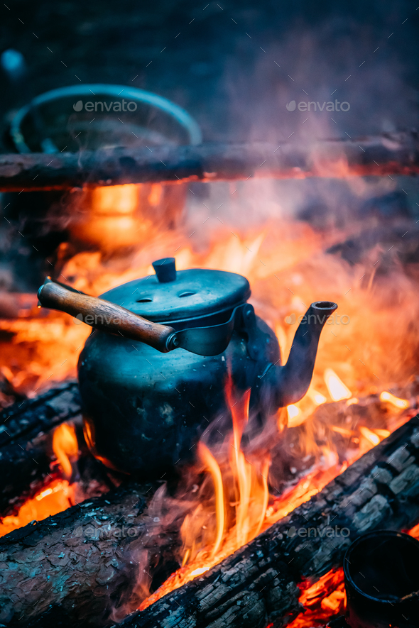 Old Retro Iron Camp Kettle Boiling Water On A Fire In Forest. Br - Stock Photo - Images
