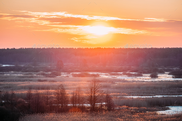 Beautiful Sunrise Over Forest And River In Early Spring. Dramati - Stock Photo - Images