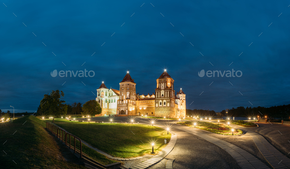 Mir, Belarus. Mir Castle Complex In Evening Illumination Lightin - Stock Photo - Images