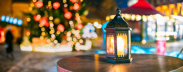 Christmas Lantern With Burning Candle On Bright Blurred Christma - Stock Photo - Images