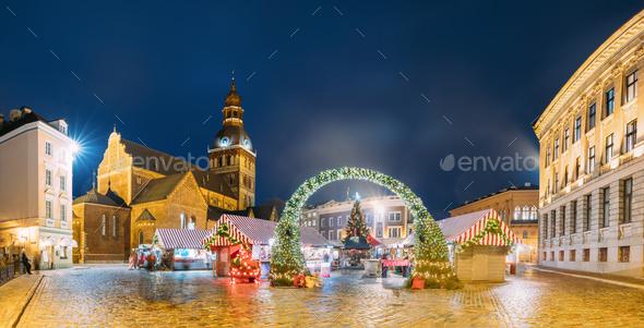 Riga, Latvia. Xmas Market On Dome Square With Riga Dome Cathedra - Stock Photo - Images