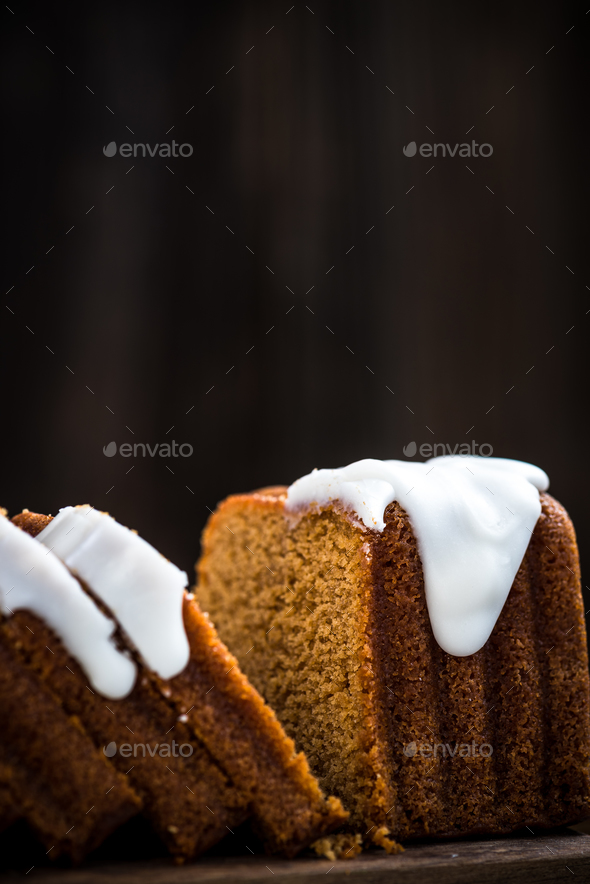Slicing Easter cake for sharing with family - Stock Photo - Images