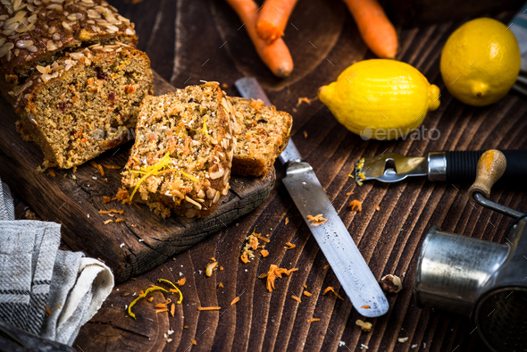 Carrot cake sliced on wooden rustic board - Stock Photo - Images