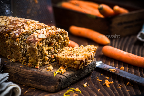 Homemade healthy carrot cake decorated with almonds and walnuts - Stock Photo - Images