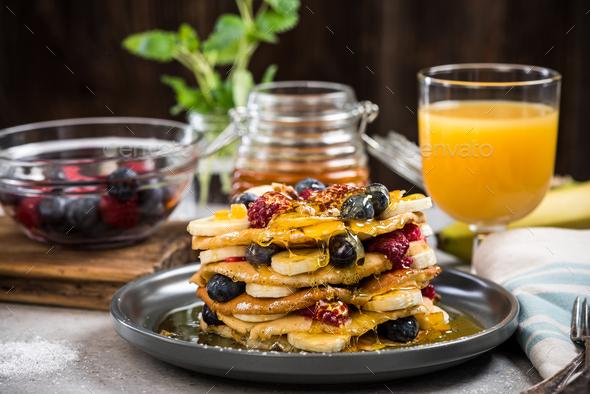 Celebrating Pancake Day or Shrove Tuesday - Stock Photo - Images