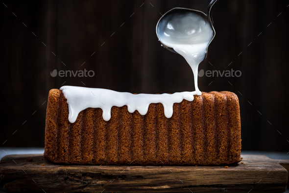 Icing top of Easter traditional cake - Stock Photo - Images