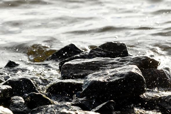 Coastal rocks on wave background - Stock Photo - Images