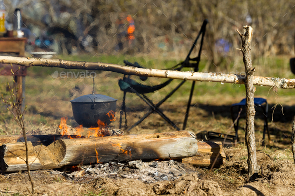 Campfire with a cooking pot - Stock Photo - Images