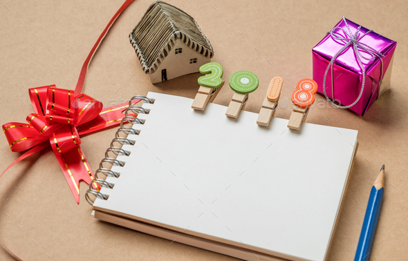 2018 on notebook,House model , gift , ribbon and pencil Put on the side. - Stock Photo - Images