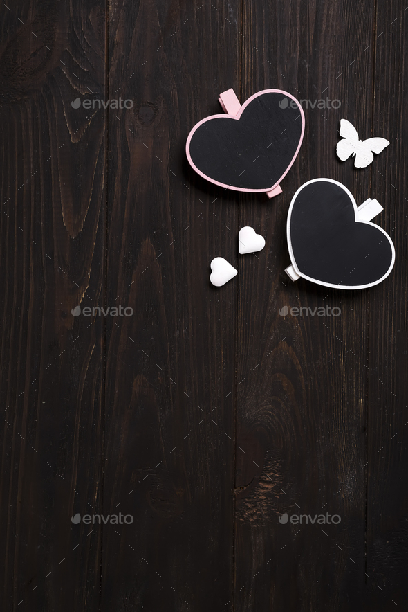 two wooden hearts with butterfly on wooden background. - Stock Photo - Images
