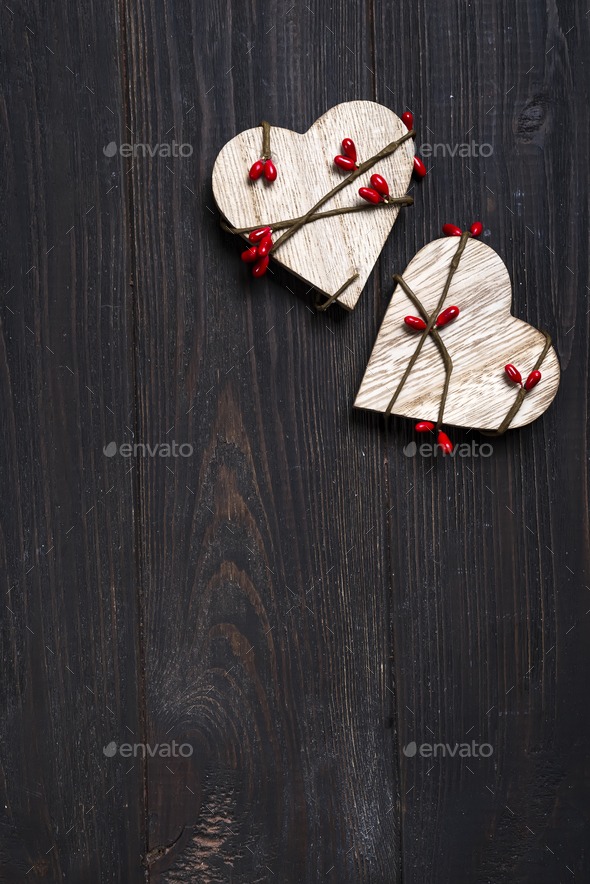 two wooden hearts on wooden background. - Stock Photo - Images