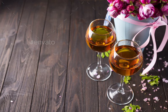 Buds of red roses and glases of wine - Stock Photo - Images