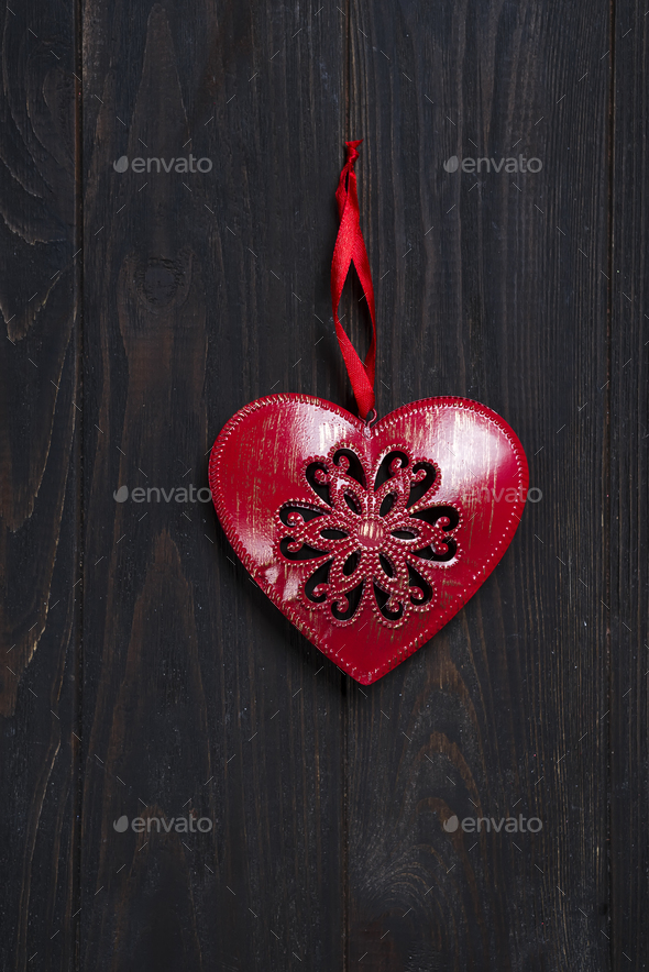 iron red heart on wooden background. - Stock Photo - Images