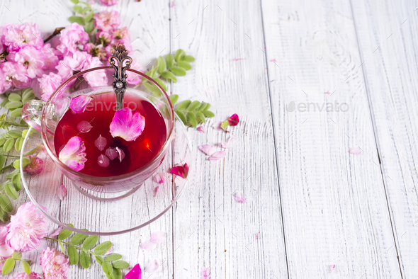 Herbal tea ingredients with flowers and cup of tea - Stock Photo - Images