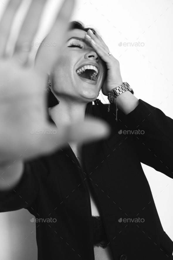 stylish crazy funny girl hiding from camera, laughing, white no isolated background - Stock Photo - Images