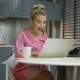 Excited Woman Using Laptop in Kitchen - VideoHive Item for Sale