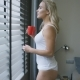 Woman in Underwear Drinking Near Window - VideoHive Item for Sale