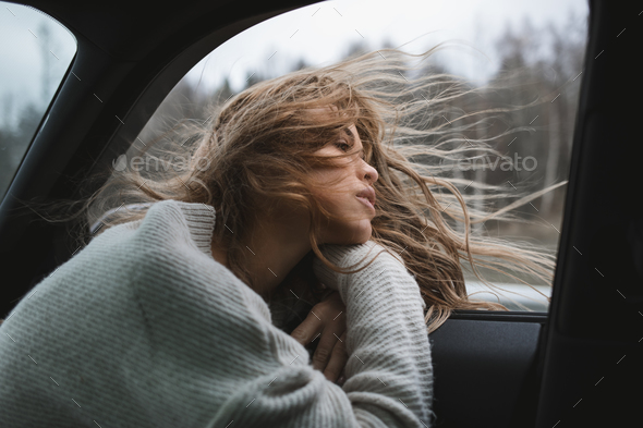 sexy thinking girl observing nature from the car - Stock Photo - Images